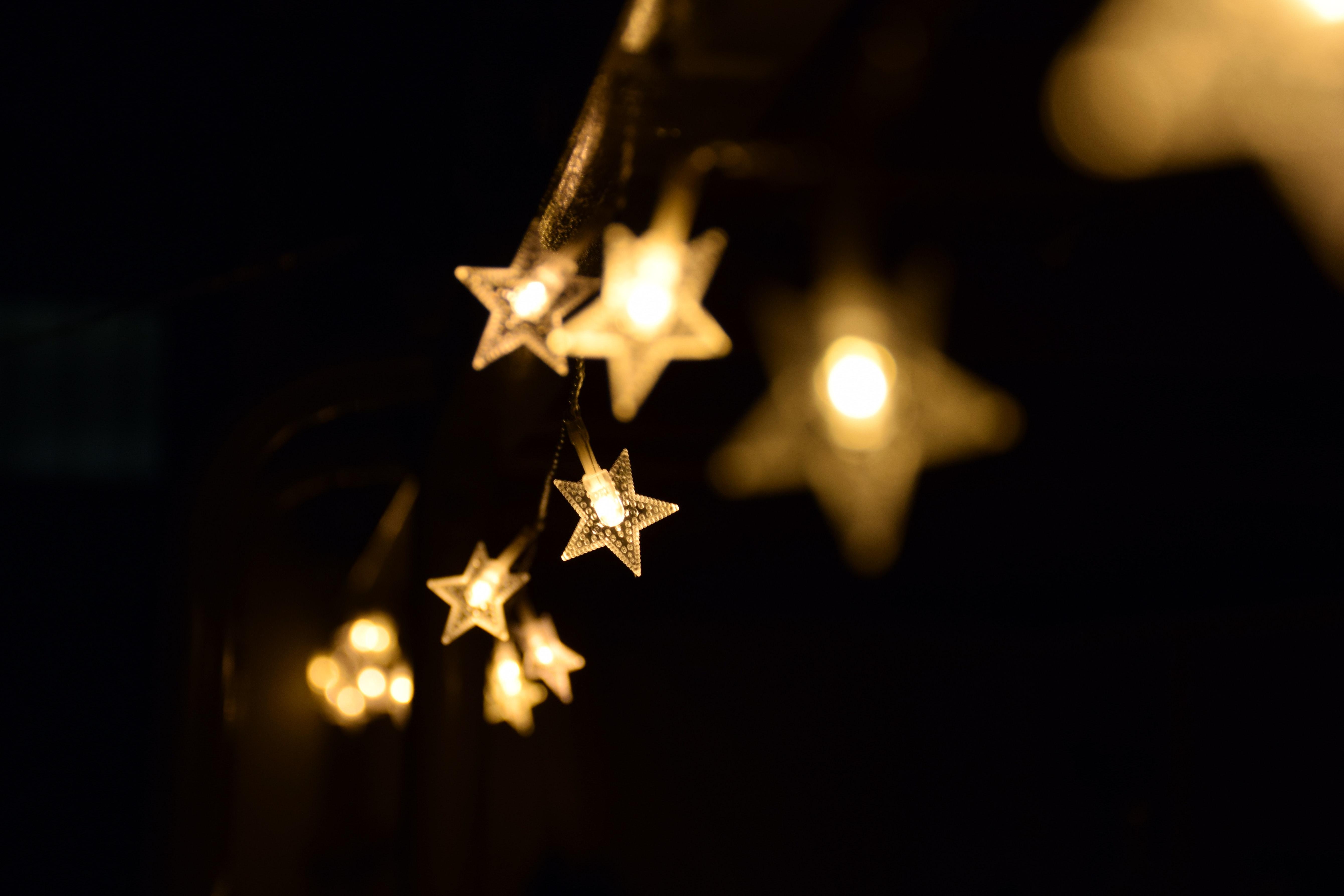 shallow-focus-photography-of-yellow-star-lanterns-980859